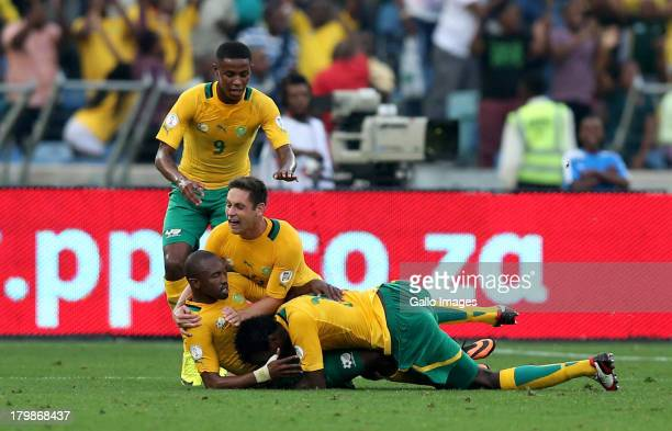 Dean Furman of South Africa and Bernard Parker of South Africa celebrate after scoring a goal during the 2014 FIFA World Cup Qualifier match between...
