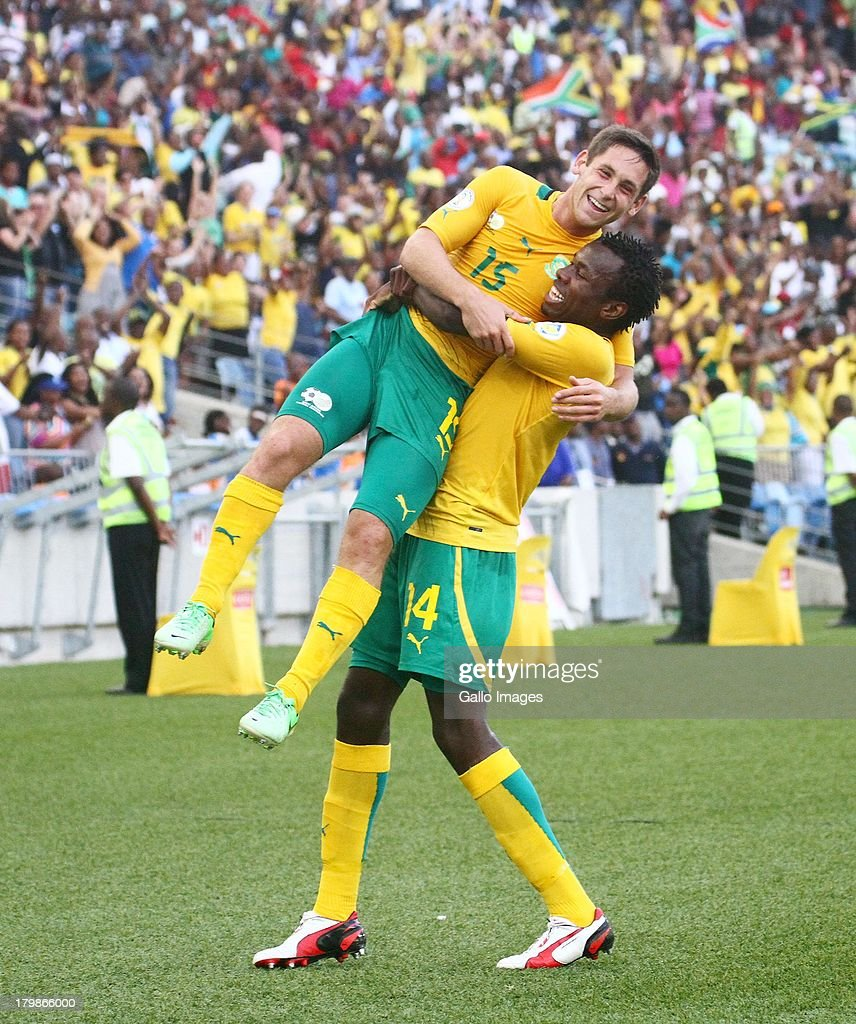 Dean Furman of South Africa celebrates his goal with <a gi-track='captionPersonalityLinkClicked' href=/galleries/search?phrase=Bongani+Khumalo&family=editorial&specificpeople=4501463 ng-click='$event.stopPropagation()'>Bongani Khumalo</a> of South Africa during the 2014 FIFA World Cup Qualifier match between South Africa and Botswana from Moses Mabhida Stadium on September 07, 2013 in Durban, South Africa.