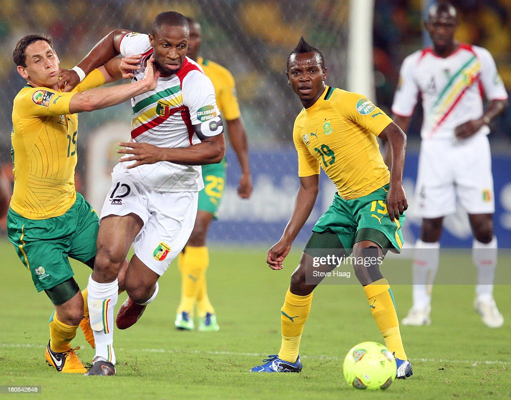 Dean Furman of South Africa pulls back Seydou Keita of Mali during the 2013 African Cup of Nations Quarter-Final match between South Africa and Mali at Moses Mahbida Stadium on February 02, 2013 in Durban, South Africa.
