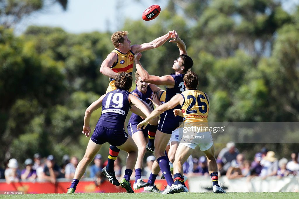 Dean Gore of the Crows contests a ruck with Alex Silvagni of the Dockers during the 2016 AFL NAB Challenge match between the Fremantle Dockers and the Adelaide Crows at Sounness Park on February 28, 2016 in Perth, Australia.