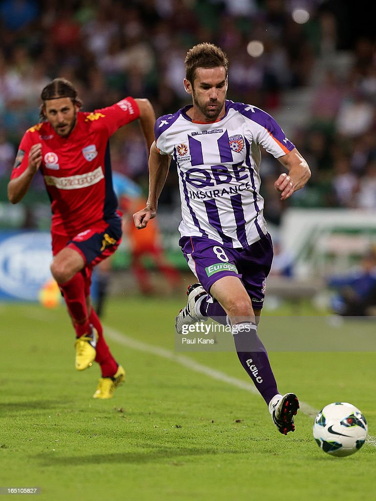 Dean Heffernan of the Glory runs onto the ball ahead of Jon McKain of Adelaide during the round twenty seven A-League match between Perth Glory and Adelaide United at nib Stadium on March 30, 2013 in Perth, Australia.