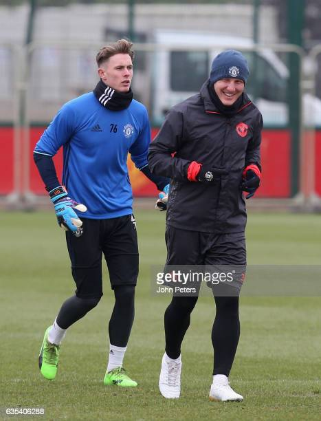 Dean Henderson and Bastian Schweinsteiger of Manchester United in action during a first team training session at Aon Training Complex on February 15...