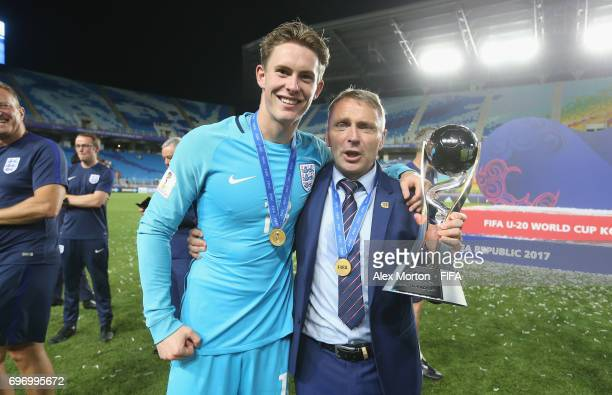 Dean Henderson of England and manager Paul Simpson ceebrate with the trophy after the FIFA U20 World Cup Korea Republic 2017 Final match between...