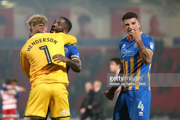 Dean Henderson of Shrewsbury Town Abu Ogogo of Shrewsbury Town and Ben Godfrey of Shrewsbury Town celebrate at full time during the Sky Bet League...