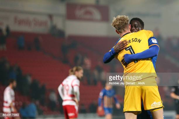 Dean Henderson of Shrewsbury Town and Arthur Gnahoua of Shrewsbury Town celebrates at full time during the Sky Bet League One match between Doncaster...