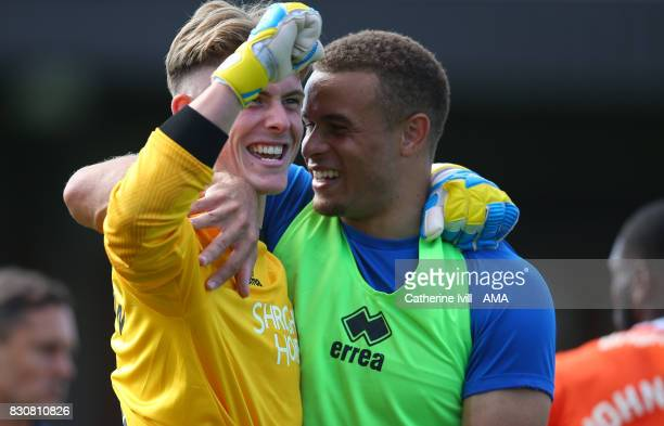 Dean Henderson of Shrewsbury Town and Carlton Morris of Shrewsbury Town celebrate during the Sky Bet League One match between AFC Wimbledon and...