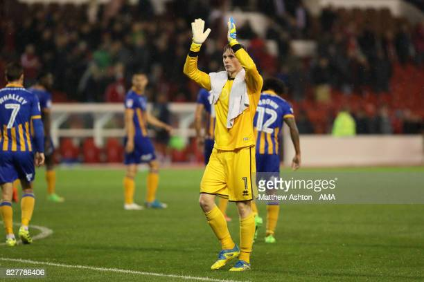 Dean Henderson of Shrewsbury Town applauds the fans at the end of the game after the Carabao Cup First Round match between Nottingham Forest and...