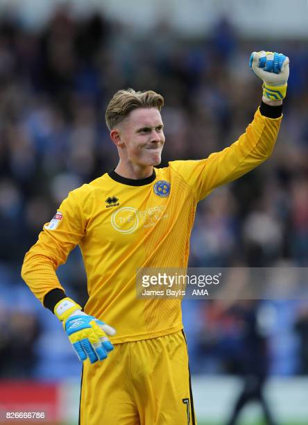 Dean Henderson of Shrewsbury Town celebrates at full time during the Sky Bet League One match between Shrewsbury Town and Northampton Town at New...