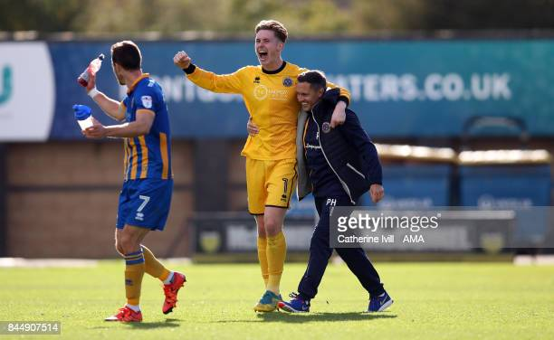 Dean Henderson of Shrewsbury Town celebrates with Paul Hurst manager of Shrewsbury Town after the Sky Bet League One match between Shrewsbury Town...
