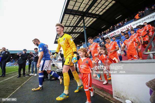 Dean Henderson of Shrewsbury Town walks out with his team mates during the Sky Bet League One match between Oldham Athletic and Shrewsbury Town at...