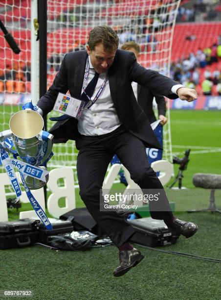 Dean Hoyle chairman of Huddersield Town celebrates with The Championship play off trophy after the Sky Bet Championship play off final between...