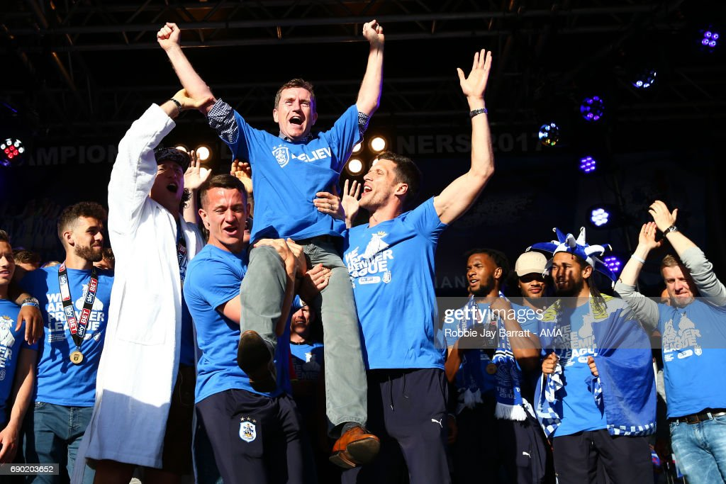 Dean Hoyle chairman / owner of Huddersfield Town is lifted aloft by Jonathan Hogg of Huddersfield Town and Mark Hudson of Huddersfield Town on May 30, 2017 in Huddersfield, England.