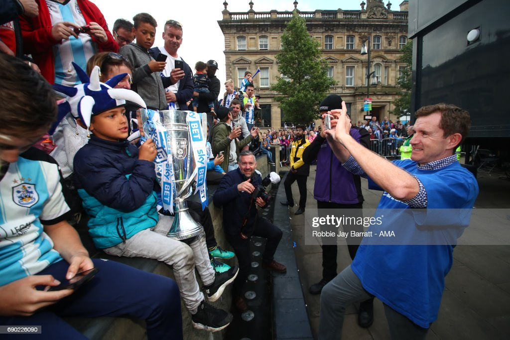 Dean Hoyle chairman / owner of Huddersfield Town takes photos of fans with the Sky Bet Championship Play off trophy on May 30, 2017 in Huddersfield, England. (Photo by Robbie Jay Barratt - AMA/Getty Images) Dean Hoyle