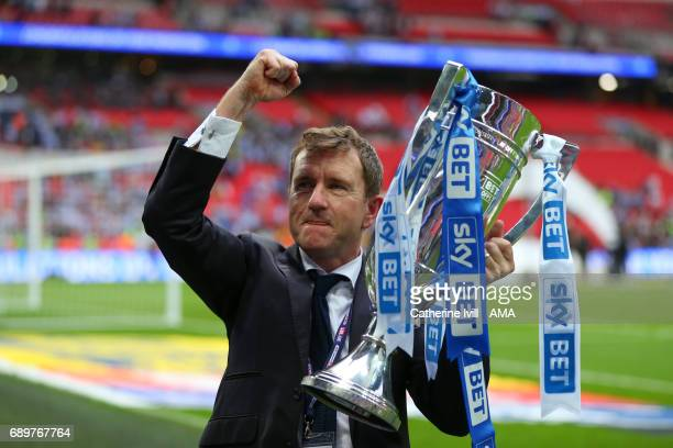 Dean Hoyle owner of Huddersfield celebrates promotion with the trophy after the Sky Bet Championship Play Off Final match between Reading and...