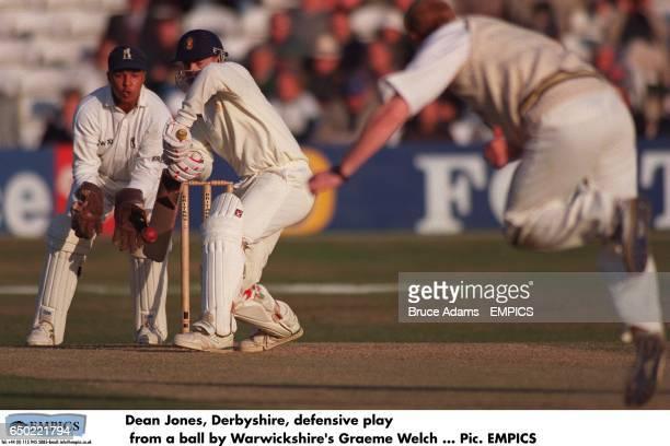 Dean Jones Derbyshire plays safe off the bowling of Warwickshire's Graeme Welch