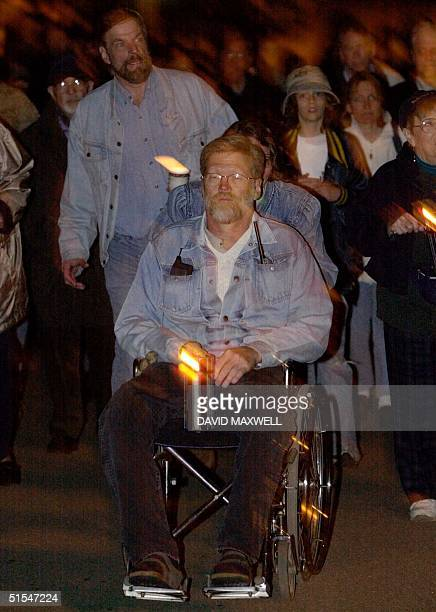 Dean Kahler leads the candle light march 03 May 2000 at Kent State University in Kent OH to commemorate the 30th anniversary of the May 4th 1970...