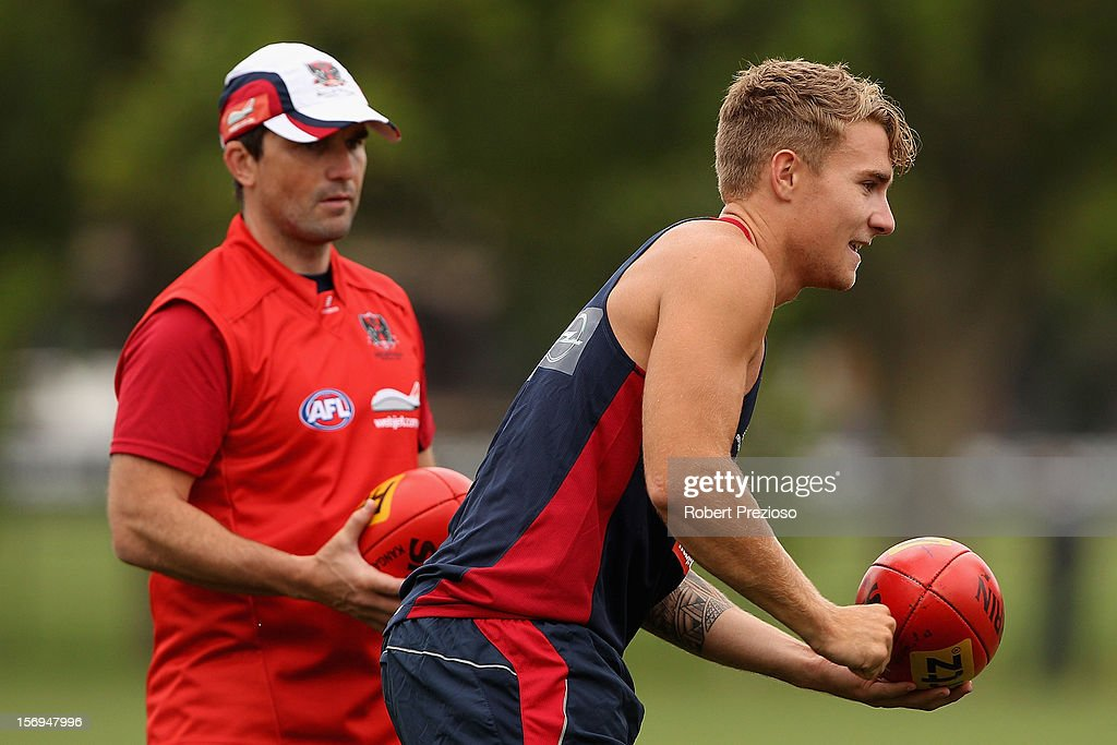 <a gi-track='captionPersonalityLinkClicked' href=/galleries/search?phrase=Dean+Kent&family=editorial&specificpeople=235553 ng-click='$event.stopPropagation()'>Dean Kent</a> handballs during a Melbourne Demons AFL pre-season training session at Gosch's Paddock on November 26, 2012 in Melbourne, Australia.