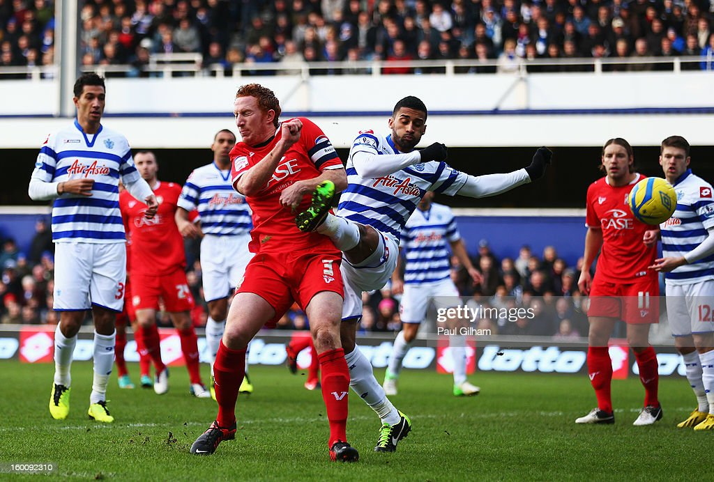 Dean Lewington (L) of Milton Keynes Dons beats Armand Traore (R) of Queens Park Rangers to be ball to score during the FA Cup with Budweiser Fourth Round match between Queens Park Rangers and Milton Keynes Dons at Loftus Road on January 26, 2013 in London, England.