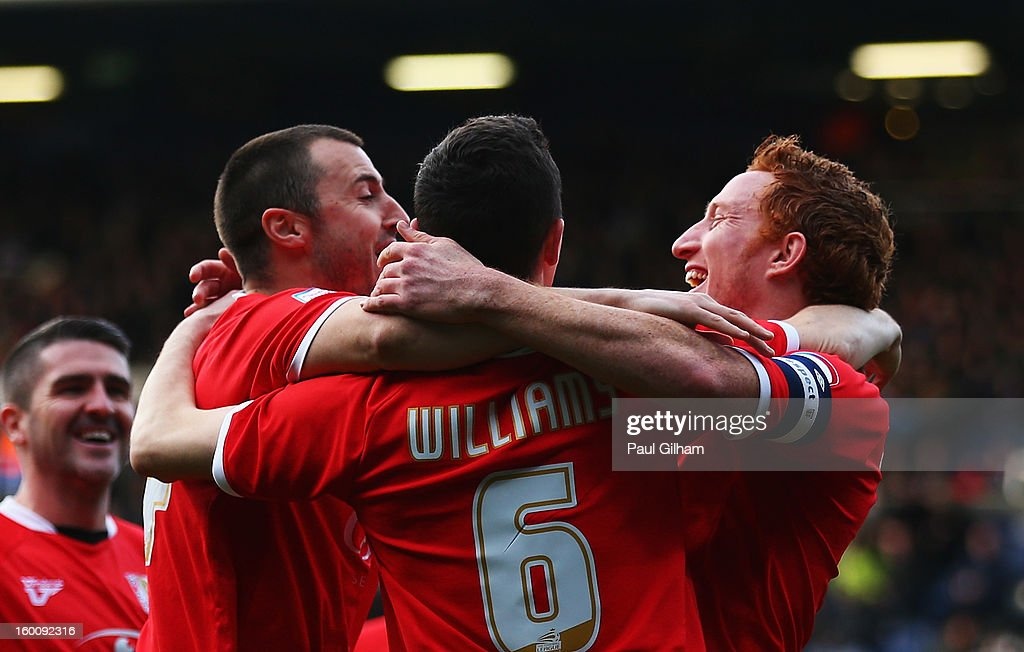 Dean Lewington (R) of Milton Keynes Dons celebrates with team mates after scoring during the FA Cup with Budweiser Fourth Round match between Queens Park Rangers and Milton Keynes Dons at Loftus Road on January 26, 2013 in London, England.