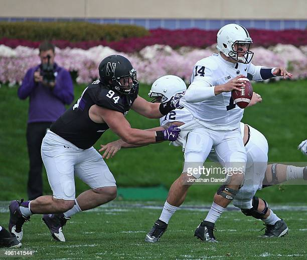 Dean Lowry of the Northwestern Wildcats sacks Christian Hackenberg of the Penn State Nittany Lions at Ryan Field on November 7 2015 in Evanston...