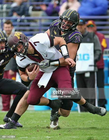 Dean Lowry of the Northwestern Wildcats sacks Mitch Leidner of the Minnesota Golden Gophers at Ryan Field on October 3 2015 in Evanston Illinois