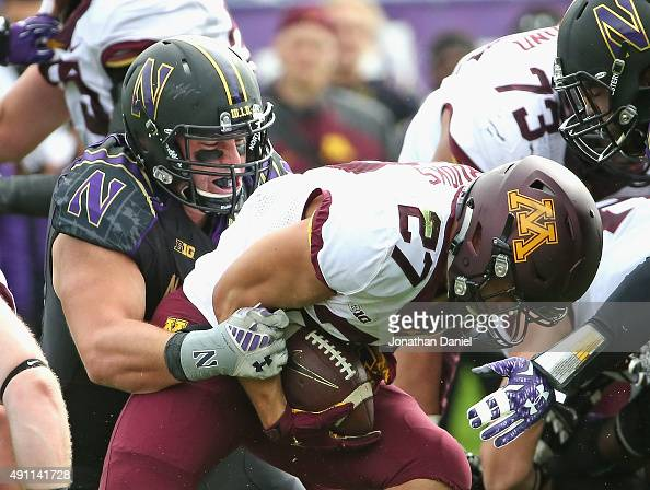 Dean Lowry of the Northwestern Wildcats tackles James Johannesson of the Minnesota Golden Gophers at Ryan Field on October 3 2015 in Evanston Illinois