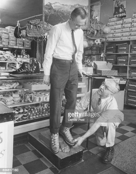 Dean Lund Denver US National Bank employee learns proper precautions for boot fit from Hans Wittman Credit Denver Post