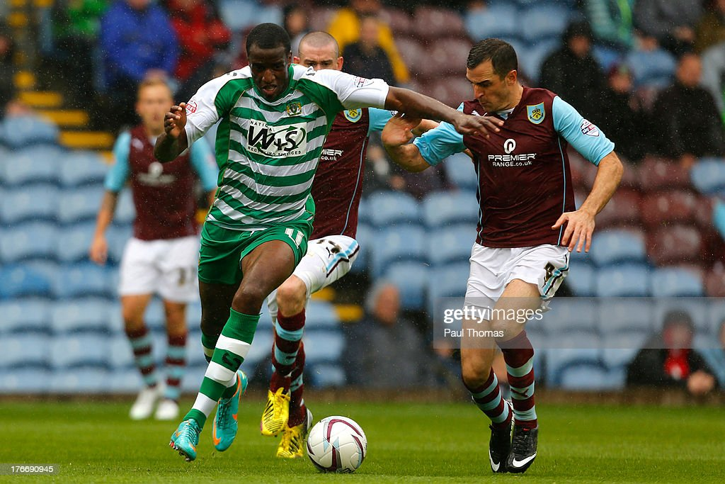 Dean Marney (R) of Burnley in action with Michael Ngoo of Yeovil during the Sky Bet Championship match between Burnley and Yeovil Town at Turf Moor on August 17, 2013 in Burnley, England