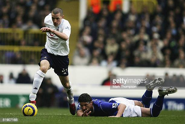 Dean Marney of Tottenham beats Alessandro Pistone of Everton during the FA Barclays Premiership match between Tottenham Hotspur and Everton at White...