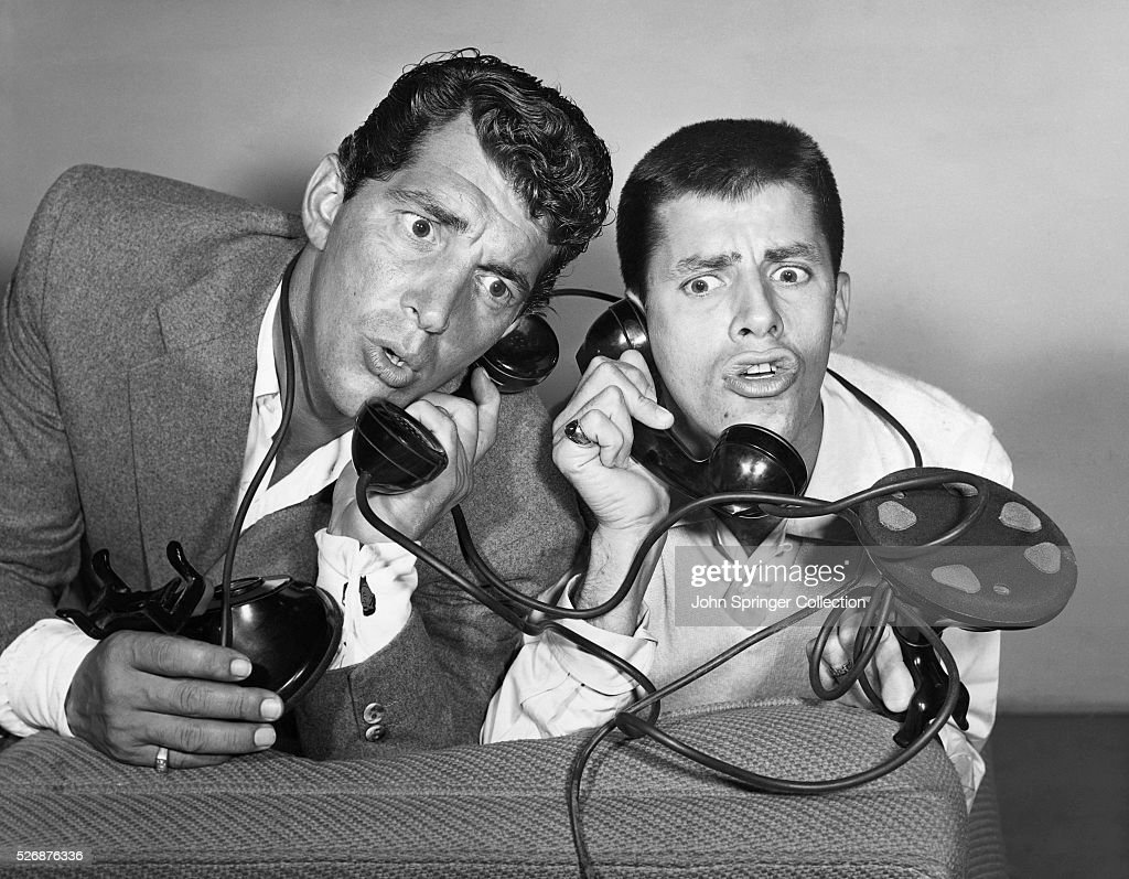 Dean Martin and Jerry Lewis, entertainers and hosts of their own NBC radio show, react at the news that the presentation of Redbook magazine's 14th Annual Silver Cup Movie Award will be made on their show.