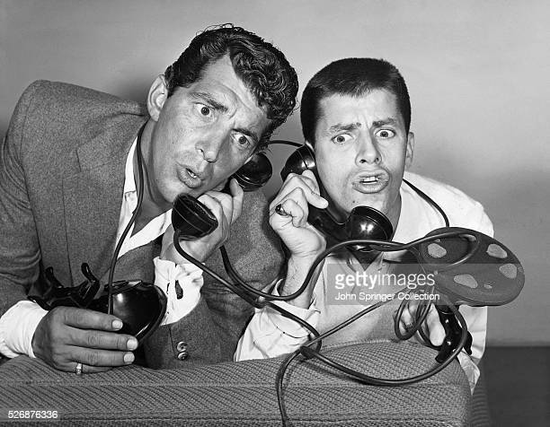Dean Martin and Jerry Lewis entertainers and hosts of their own NBC radio show react at the news that the presentation of Redbook magazine's 14th...