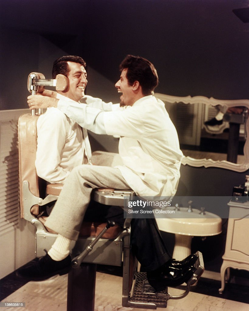Dean Martin (1917-1995), US actor and singer, sitting in a barber's chair with <a gi-track='captionPersonalityLinkClicked' href=/galleries/search?phrase=Jerry+Lewis+-+Com%C3%A9dien&family=editorial&specificpeople=202947 ng-click='$event.stopPropagation()'>Jerry Lewis</a>, US actor and comedian, sitting over him, both smiling, USA, circa 1955.