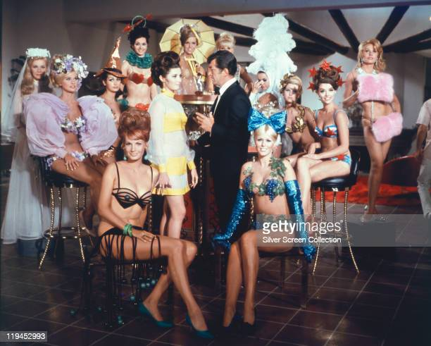 Dean Martin US actor and singer surrounded by the 'Slaygirls' in a publicity image issued for the film 'Murderers' Row USA 1966 The spy comedy...