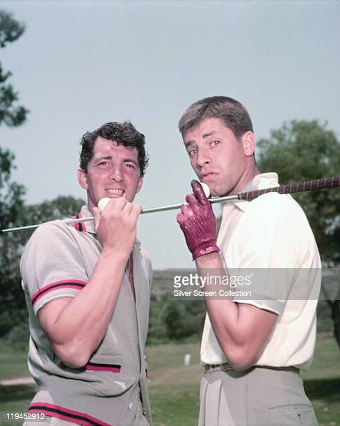 Dean Martin US actor and singer with Jerry Lewis US actor and comedian posing with each holding opposite ends of a golf club USA circa 1952