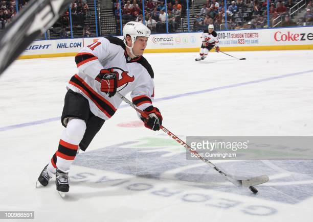 Dean McAmmond of the New Jersey Devils carries the puck against the Atlanta Thrashers at Philips Arena on April 6 2010 in Atlanta Georgia