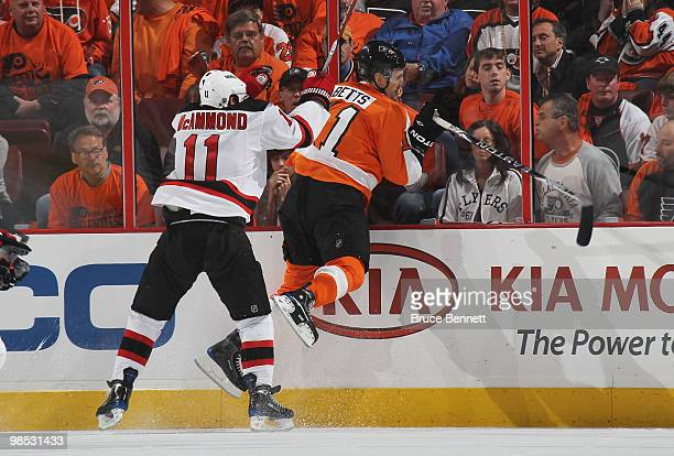Dean McAmmond of the New Jersey Devils hits Blair Betts of the Philadelphia Flyers in Game Three of the Eastern Conference Quarterfinals during the...