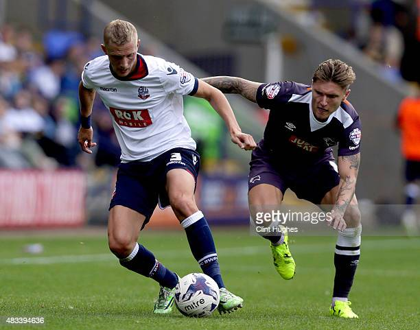 Dean Moxey of Bolton Wanderers and Jeff Hendrick of Derby County battle for the ball during the Sky Bet Championship match between Bolton Wanderers...