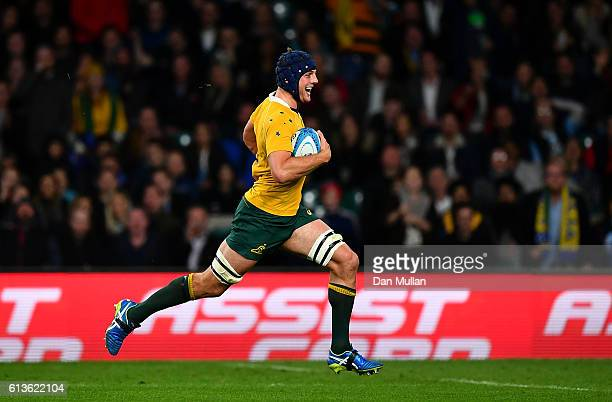 Dean Mumm of Australia makes a break to score a try during the Rugby Championship match between Argentina and Australia at Twickenham Stadium on...