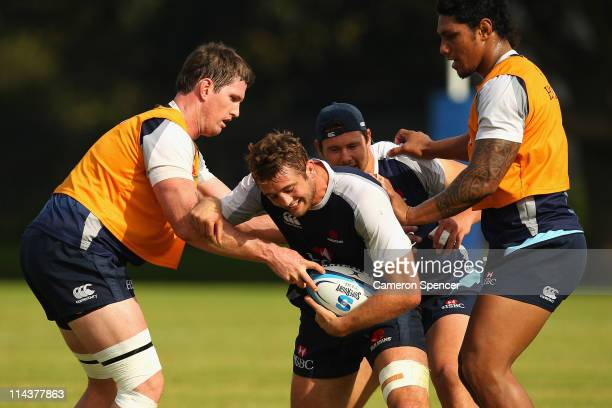Dean Mumm of the Waratahs is tackled during a Waratahs Super Rugby training session at Moore Park on May 19 2011 in Sydney Australia