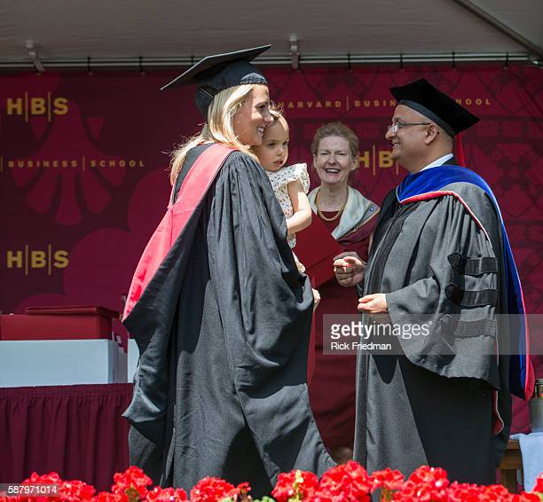 Dean Nitin Nohria of the Harvard Business School presenting her diploma to Jaclyn Shanahan during Commencement Ceremonies in Boston MA on May 29 2014