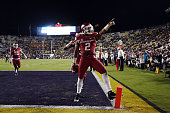 J Dean of the Arkansas Razorbacks celebrates following an interception in the endzone during a game against the LSU Tigers at Tiger Stadium on...