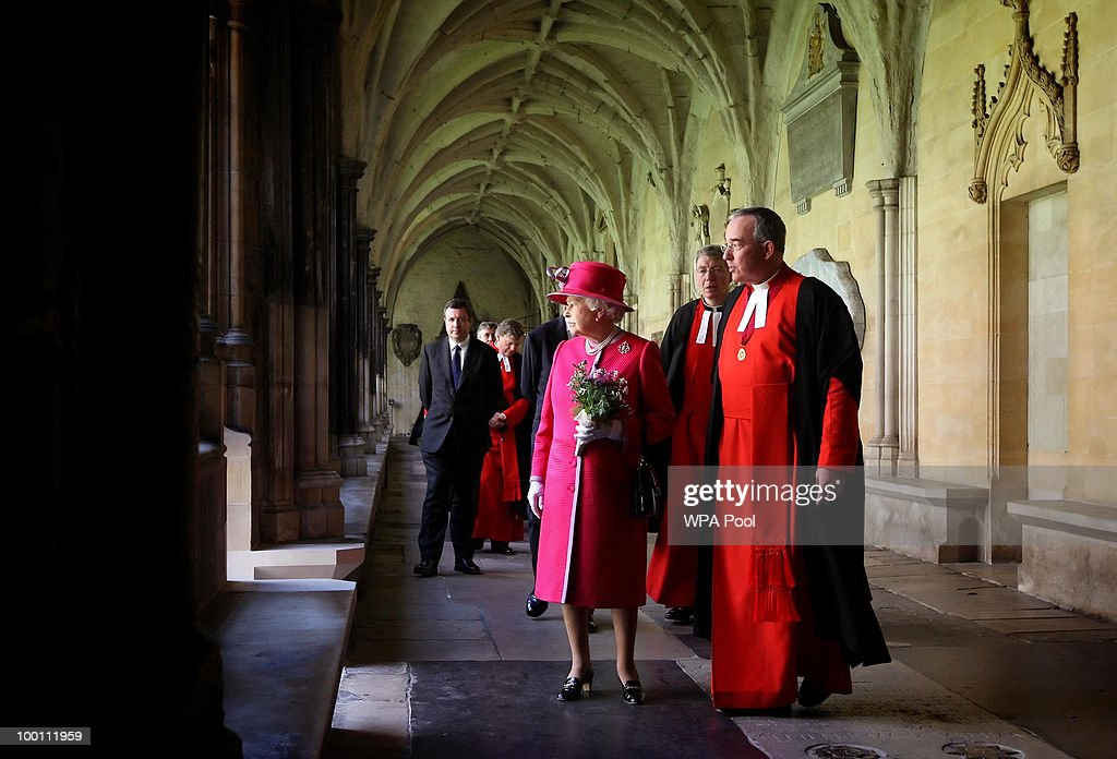 Dean of Westminster Dr John Hall (R )and Britain's Queen Elizabeth II walk through the cloisters of Westminster Abbey, during a visit to Westminster Abbey and Westminster School, on the 450th anniversary of the granting of their Royal Charter by Queen Elizabeth I, on May 21, 2010 in London, England.
