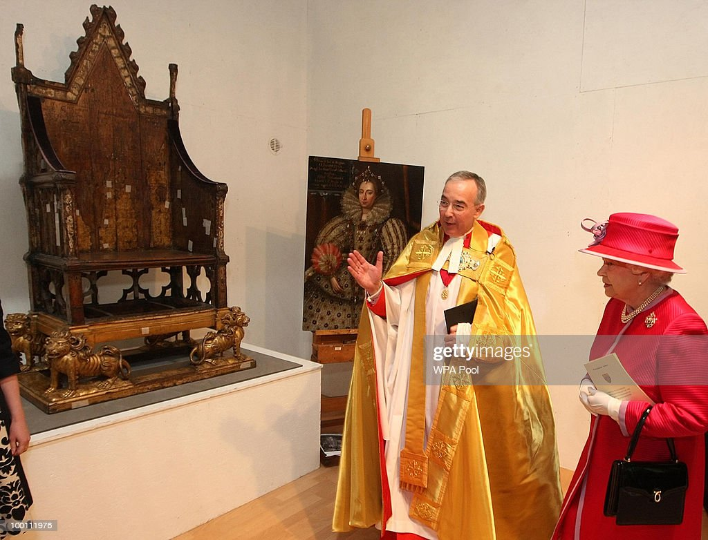 Dean of Westminster Dr John Hall shows Britain's Queen Elizabeth II the coronation chair, which has been used in the coronation of every British monarch since 1308, during a visit to Westminster Abbey and Westminster School, on the 450th anniversary of the granting of their Royal Charter by Queen Elizabeth I, on May 21, 2010 in London, England.