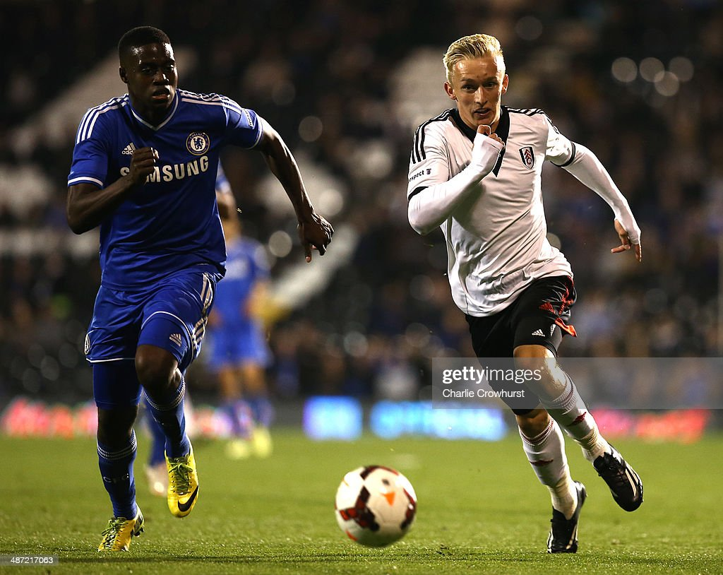 Dean O'Halloran (R) of Fulham looks to get past Isak Ssewankambo of Chelsea during the FA Youth Cup Final: First Leg match between Fulham and Chelsea at Craven Cottage on April 28, 2014 in London, England.
