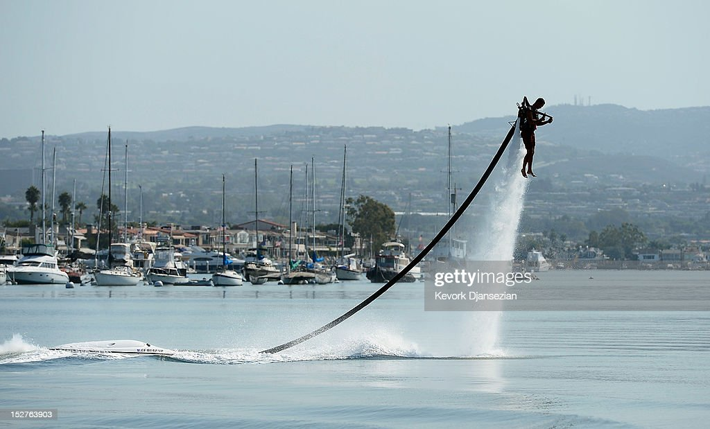 Dean O'Malley flies using a JetLev, a water-powered jetpack flying machine in the Newport Beach harbor on September 25, 2012 in Newport Beach, California. O'Malley will attempt to establish a new world record for flight of the JeLev by making a 26 mile open ocean crossing from Newport Beach to Avalon, Catalina Island on September, 29, 2012.