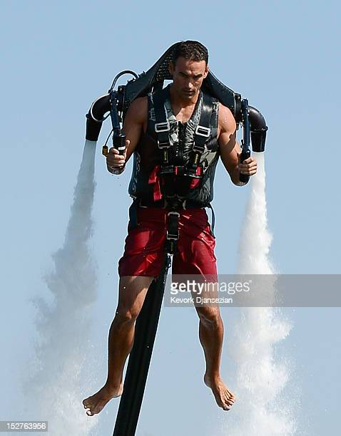 Dean O'Malley flies using a JetLev a waterpowered jetpack flying machine in the Newport Beach harbor on September 25 2012 in Newport Beach California...