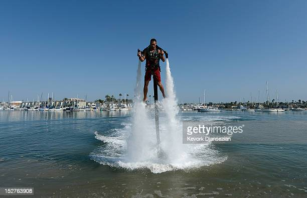 Dean O'Malley rises above the water using a JetLev a waterpowered jetpack flying machine in the Newport Beach harbor on September 25 2012 in Newport...