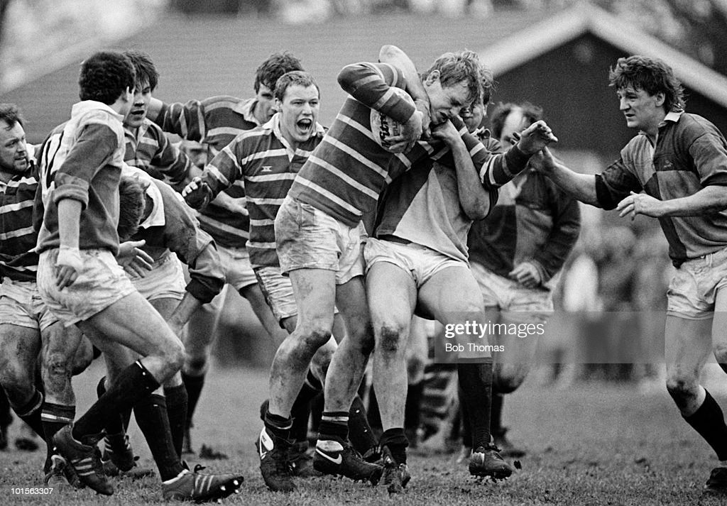 Dean Richards of Leicester is held by Paul Jackson of Harlequins during the John Player Special Cup Quarter-final rugby union match held at The Stoop, London on 22nd March 1986. Leicester beat Harlequins 15-8. (Bob Thomas/Getty Images).