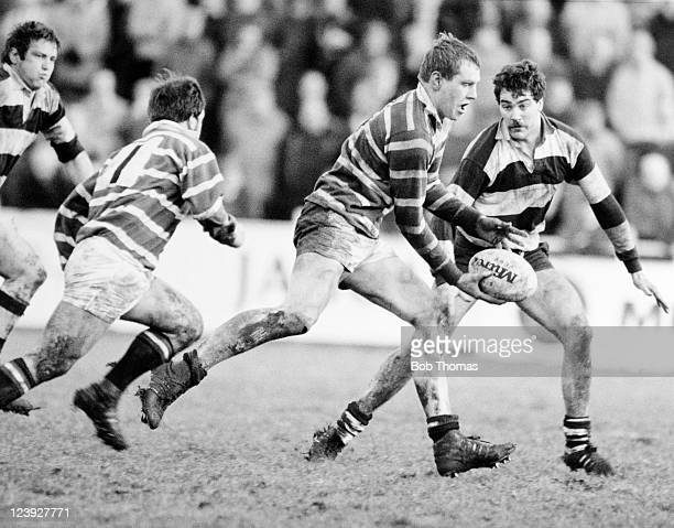 Dean Richards of Leicester supported by scrumhalf Steve Kenney passes the ball as Paul Thomas of Coventry prepares to challenge during the Rugby...