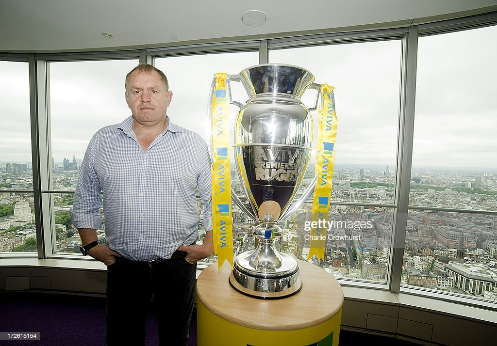 Dean Richards of Newcastle Falcons stands with the Aviva Premiership Trophy during the 2013-14 Aviva Premiership Rugby Season Fixtures Announcement at The BT Tower on July 4, 2013 in London, England.